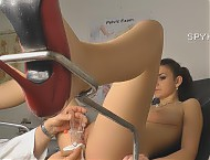 Undressed female patient caught during laying on t...