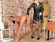 Office mistress interviewing a shocked undressed g...