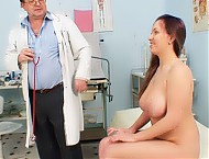 Busty brunette gets a gyno instrument up her pussy