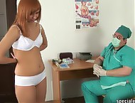 Redhead student examined by a strange doctor